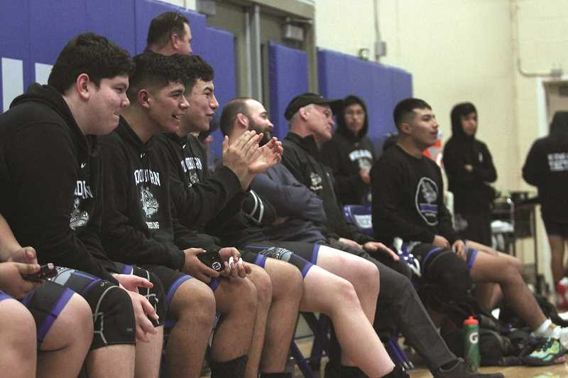 PMG PHOTO: PHIL HAWKINS - The Woodburn wrestlers cheer on from the sidelines in the Bulldogs 56-18 win over Banks.