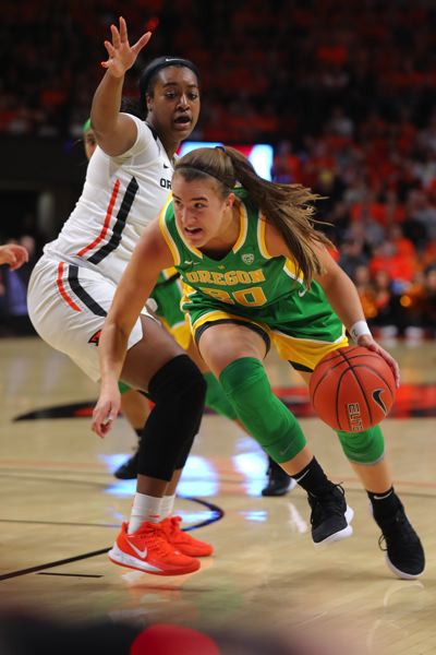 PMG PHOTO: JAIME VALDEZ - Oregon Ducks guard Sabrina Ionescu (20) dribbles around Oregon State Beavers guard Madison Washington (3) in the second half at Gil Coliseum on Jan. 26, 2019.