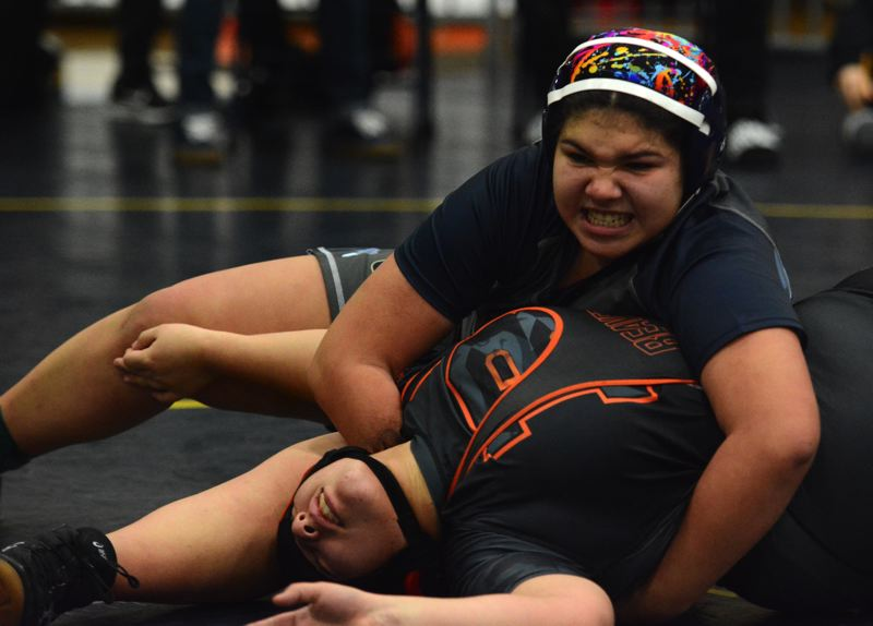 PMG PHOTO: DEREK WILEY - Canby sophomore Yared Calderon wrestles Beaverton junior Maria Reeder at the Larry Owings Invitational.