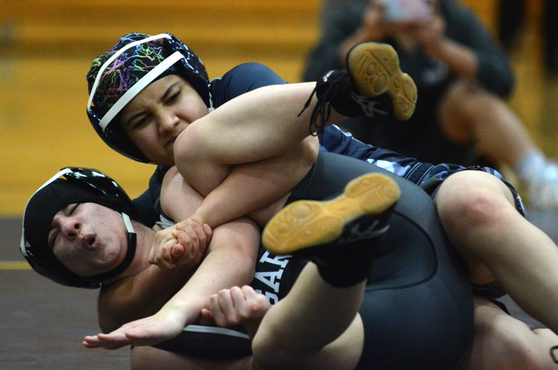 PMG PHOTO: DEREK WILEY - Marisol Rosiles-Malason wrestles at Canby High School.