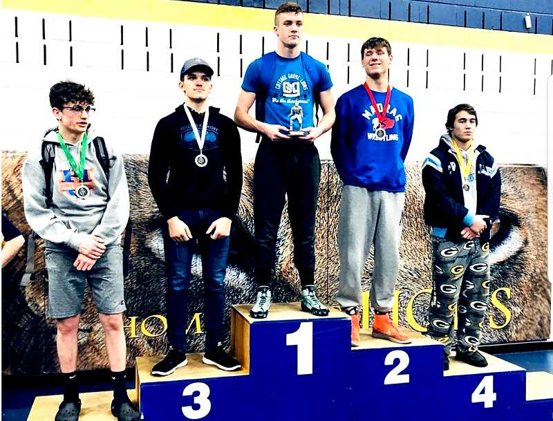 SUBMITTED PHOTO - Reece White places second at the Cottage Grove Invitational Jan. 31-Feb. 1. The Madras wrestling team scored 193.5 points to claim bronze. McKay scored 194 points to edge out the Buffalos for second place.