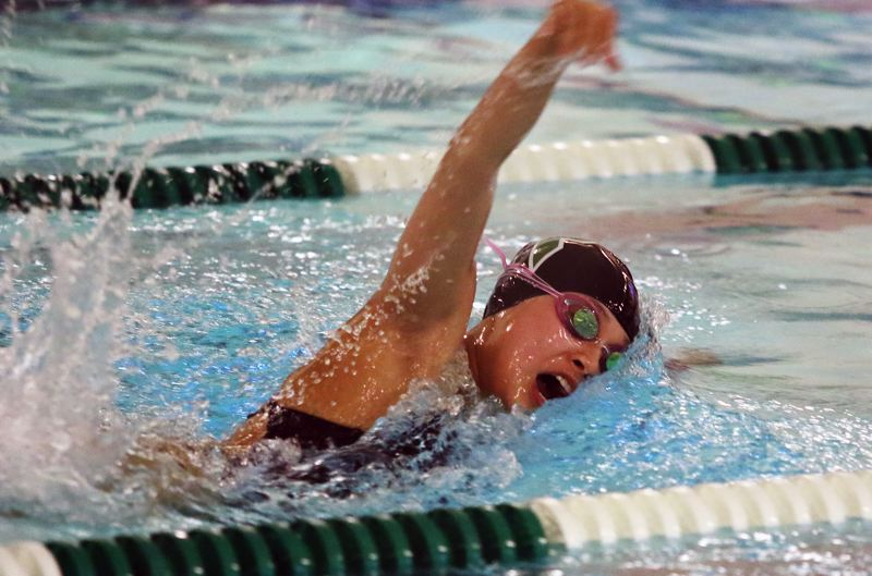 PMG PHOTO: DAN BROOD - Tigard High School freshman Shannon Liang is on her way to victory in the 100-yard freestyle event during the Tigers' Three Rivers League meet with Lake Oswego.