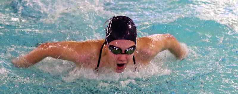 PMG PHOTO: DAN BROOD - Tigard's Caileigh Flowers in on her way to a second-place finish in the 100-yard butterfly event during the Tigers' Three Rivers League meet with Lake Oswego.