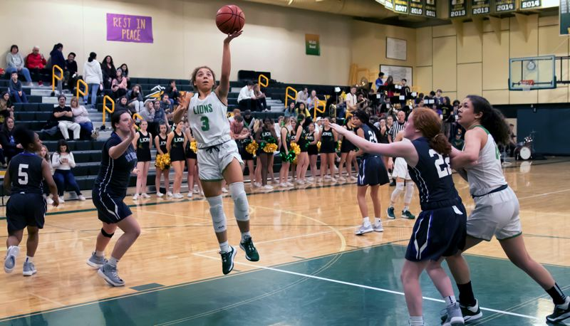 COURTESY GENE SCHWARTZ - West Linn sophomore guard Alana Molden goes up for two of her 12 points during the Lions' 78-36 win over St. Mary's at West Linn High School on Friday, Jan. 31.
