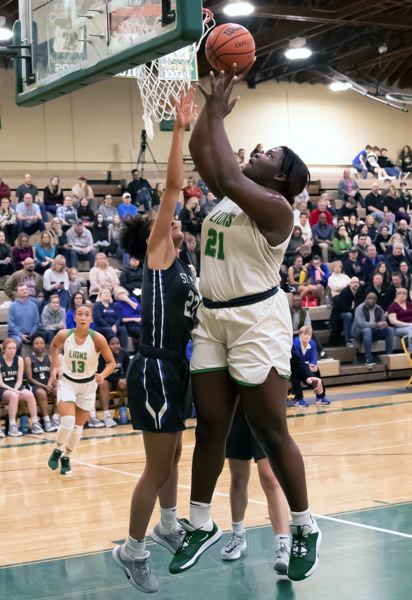 COURTESY GENE SCHWARTZ - West Linn junior post Aaronette Vonleh dominated with 29 points during the Lions' 78-36 win over St. Mary's at West Linn High School on Friday, Jan. 31.