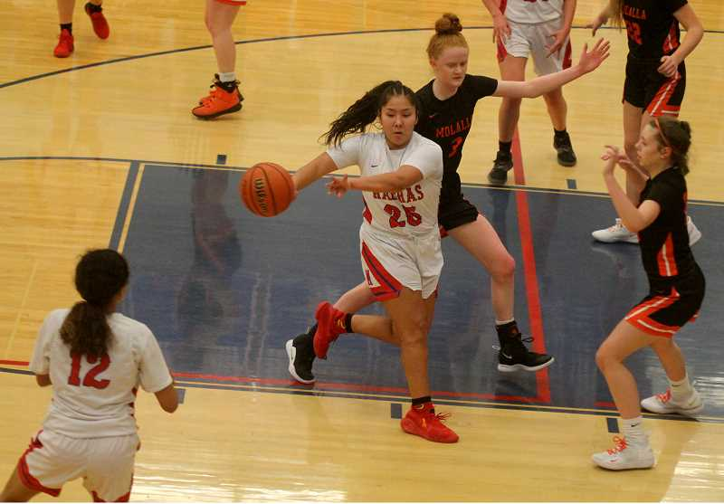STEELE HAUGEN -  Jiana Smith-Francis makes a no-look pass during the Lady Buffs' 50-41 home loss to Molalla Jan. 31.  Smith-Francis was the leading scorer with 13 points for Madras.