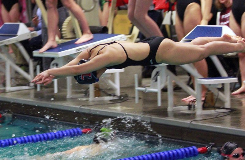 PMG PHOTO: MILES VANCE - Tualatin's Esther Ho dives into her leg of the 200-yard freestyle relay during her team's 98-72 loss to West Linn at Tualatin Swim Center on Thursday, Jan. 30.