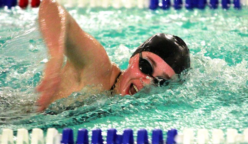 PMG PHOTO: MILES VANCE - Tualatin's Britney Muralt races through the anchor leg of the 400-yard freestyle relay during her team's 98-72 loss to West Linn at Tualatin Swim Center on Thursday, Jan. 30.