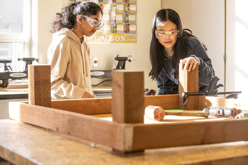 PMG PHOTO: JONATHAN HOUSE - Ishita Jayadev, left, and Katelyn Chen help build a table for the Bonnie L. Hays Animal Shelter, as part of a community service project at Westview High.