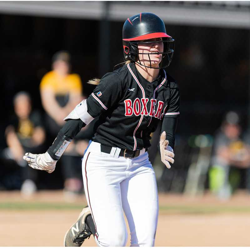 PMG PHOTO: CHRISTOPHER OERTELL - Pacific's Becca Bernard runs the bases during a Boxers softball game last spring at Sherman/Larkins Stadium in Forest Grove.