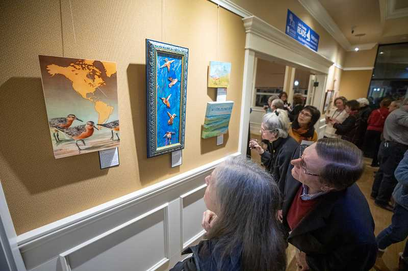 PMG PHOTO: JONATHAN HOUSE  - Attendees check out the artwork featured in this year's Lake Oswego Reads reception.