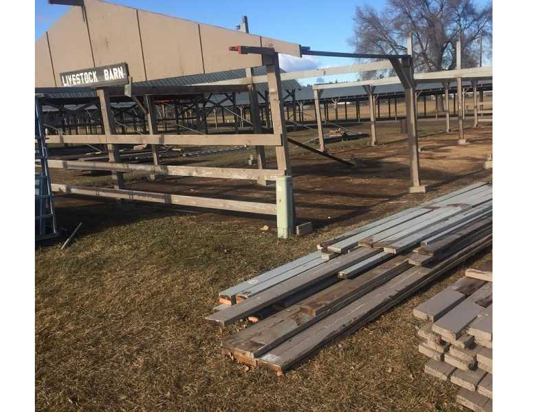 SUBMITTED PHOTO - Members of the Jefferson County Historical deconstructed the livestock barn at the Jefferson County Fairgrounds. They will rebuild it near the homestead house and use it to store antique equipment.