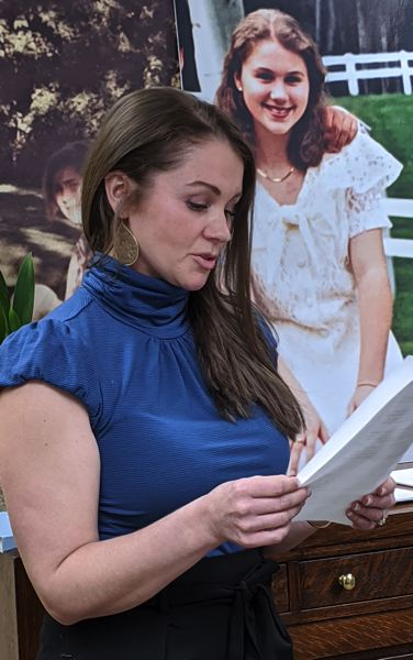 PMG PHOTO: COURTNEY VAUGHN - Sarah Jones reads a statement following the announcement that she, along with four others, filed lawsuits against their former private school, Catlin Gabel for various forms of abuse. Behind Jones is a photo of her on the day of her eighth grade promotion.