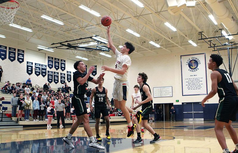 PMG PHOTO: MILES VANCE - Lake Oswego senior Casey Graver (shown here against Tigard) and the Lakers knocked off Canby 59-48 on Friday, Jan. 31, to stay unbeaten in Three Rivers League play.