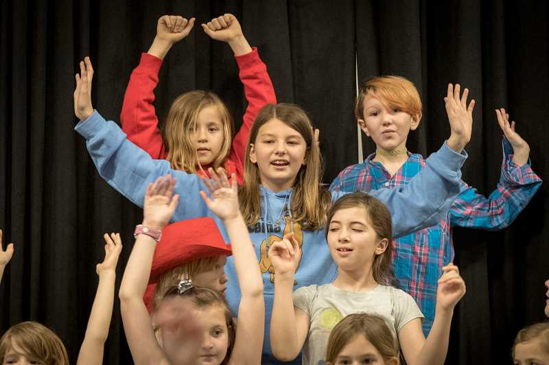 """PHOTO: JAIME VALDEZ - Cecil Abel, a fifth grader at Willamette Primary who is playing the part of Annie in """"Annie's Hard Knock Life"""" rehearses a school play production with her classmates at the school."""
