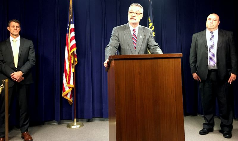 OREGON CAPITAL BUREAU: SAM STITES - U.S. Attorney Billy Williams (center) addresses the media regarding cyber and disinformation threats to the security of Oregon's electoral process during a press conference at the Oregon Capitol Tuesday, Feb. 4. Steve Trout (right), Oregon Elections Division Director, and Renn Cannon (left) FBI Portland division special agent in charge, also spoke on how government partnerships are protecting the integrity of Oregon's elections system.