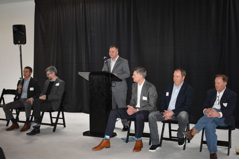 PMG PHOTO: SHANNON O. WELLS - Matt Miller of Greater Portland Inc. moderates a panel discussion featuring, from left, Michael Nagy, Matt Brown, Jay Featherston, Brent Parry and Mike Greenslade.