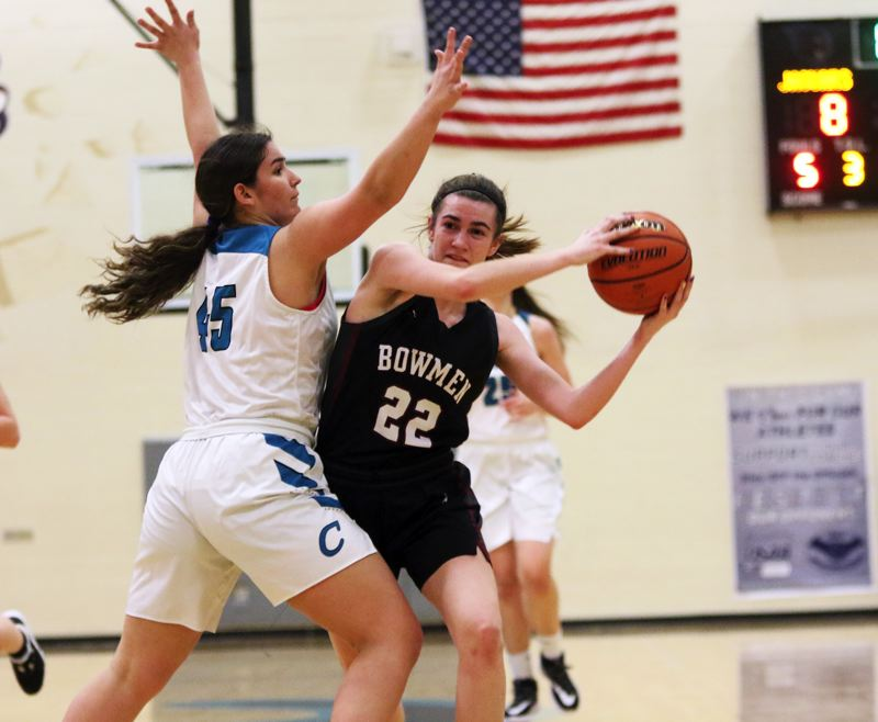 PMG PHOTO: DAN BROOD - Sherwood High School senior Julia Leitzinger (22) looks to get past Century senior Olivia Boone during Tuesday's Pacific Conference game. The Lady Bowmen won 42-29.