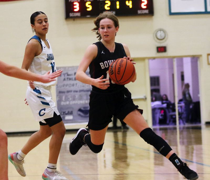 PMG PHOTO: DAN BROOD - Sherwood High School junior Joley Sproul (right) controls the ball in front of Century senior Angela Baltazar during Tuesday's Pacific Conference game.