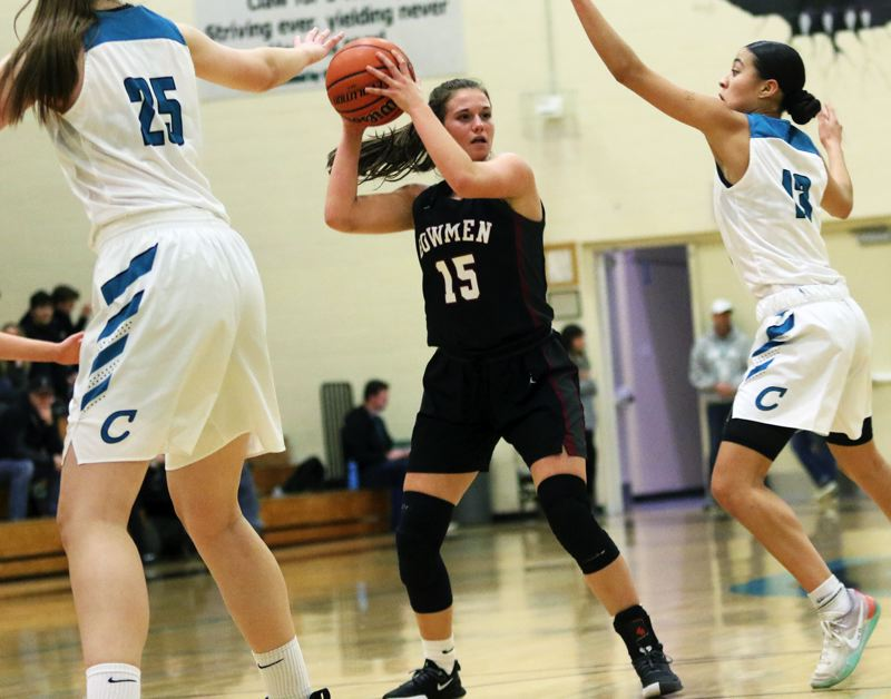 PMG PHOTO: DAN BROOD - Sherwood High School sophomore Mandie Jensen (15) looks to work the ball inside during the Lady Bowmen's 42-29 win at Century on Tuesday.