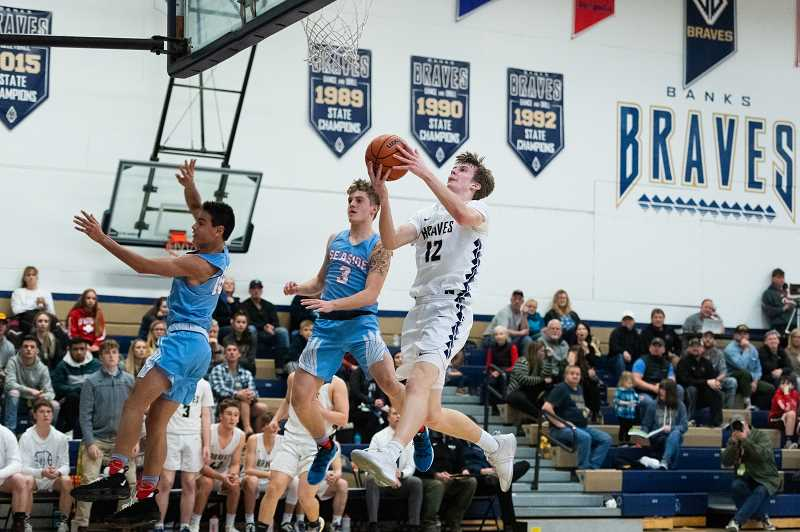 Banks' Jacob Slifka (12) during a boys basketball against Seaside at Banks High School in Banks, Ore., on Tuesday, Feb. 4, 2020.