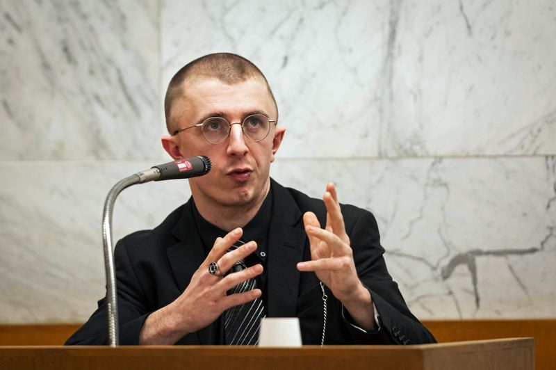 POOL PHOTO: R. FERN, OREGONIAN/OREGONLIVE - Micah Fletcher, the surviving victim of the 2017 MAX stabbings on a Portland light rail car, testified Tuesday, Feb. 4, in the trial of Jeremy Christian.