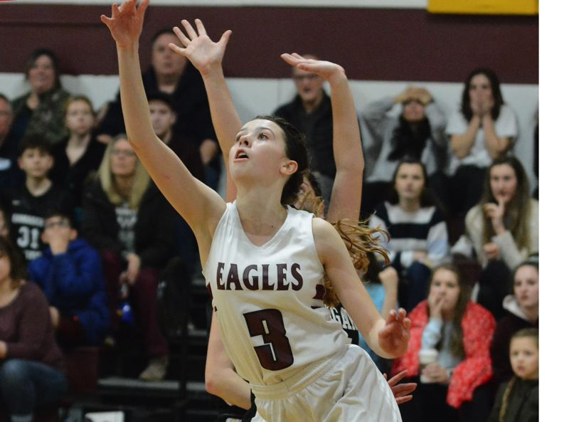 PMG PHOTO: DAVID BALL - Damascus Christians Emily Powers watches the ball after releasing the winning floater with 0:03 left in the Eagles 44-43 win over Country Christian on Monday night.