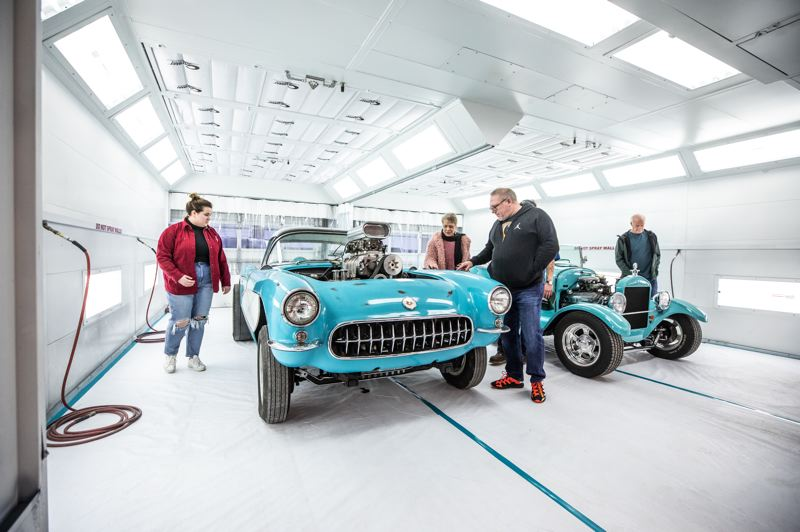 PMG PHOTO: JONATHAN HOUSE - Attendees at Clackamas Community College's Automotive Expansion Grand Opening on Jan. 31 check out classic cars undergoing restorations.