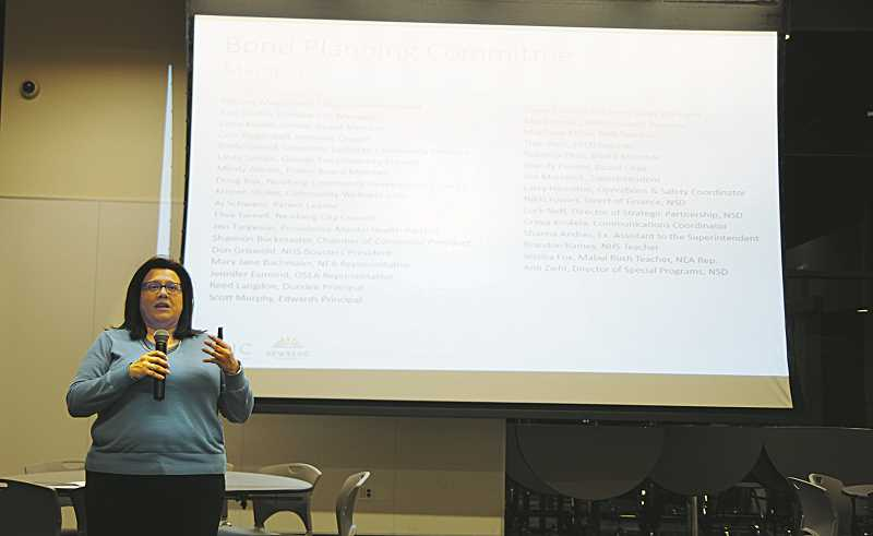 GRAPHIC PHOTO: GARY ALLEN - BRIC Architecture's Karina Ruiz speaks to attendees at last week's school informational meeting at Newberg High School.