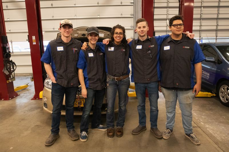 PMG PHOTO: JONATHAN HOUSE - CCC Collision Repair Program students (from left) Joseph Reed, Cody Shier, Emily Garrison, Cameron Johnson, and Jonathan Lorenzo attend the Automotive Expansion Grand Opening.
