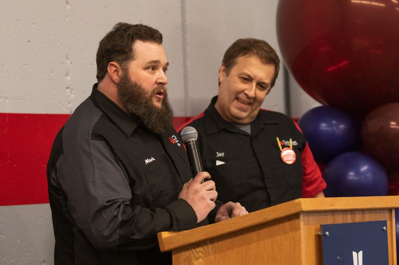 PMG PHOTO: JONATHAN HOUSE - Clackamas Community College automotive department instructors Mark House, left, and Jay Leuck talk to attendees about the college's automotive degree programs.