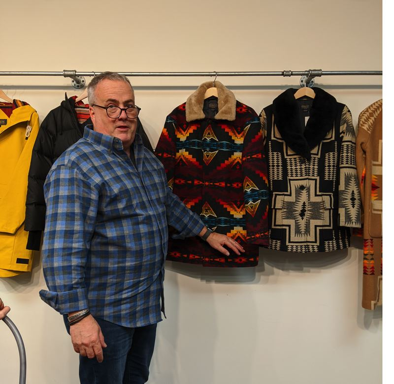 COURTESY: PENDLETON WOOLEN MILLS - Bob Christnacht, the EVP of Sales and Marketing for Pendleton Woolen Mills, at the company's Portland offices in front of the Winter 2020 line of casual, rain and technical outerwear.