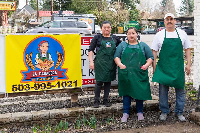 COURTESY PHOTO: CHRISTOPHER OERTELL - Owner Lucia Trinidad-Cauich (left) stands with two of her employees outside of the La Panadera bakery in Forest Grove. The bakery offers sweet and savory breads, desserts and cakes.