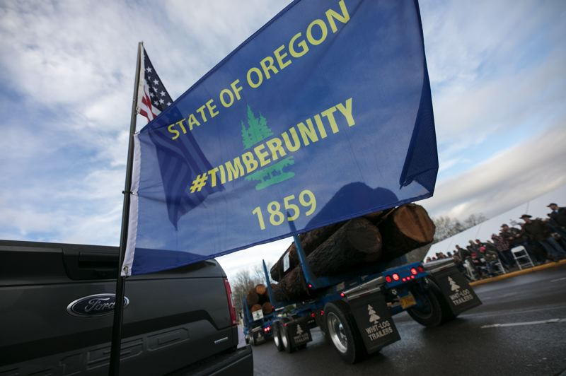 PMG PHOTO: JAIME VALDEZ - Trucks of all sizes drove near the Capitol Thursday morning, Feb. 6, as part of the Timber Unity rally.