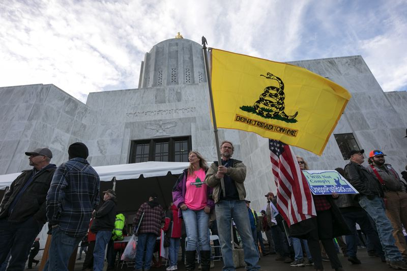 PMG PHOTO: JAIME VALDEZ - Timber Unity supporters made noise outside the Capitol Thursday, Feb. 6, during a rally opposing proposed carbon-reduction legislation.