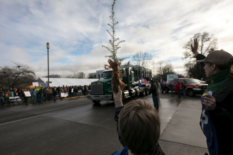 PMG PHOTO: JAIME VALDEZ - Families joined the Timber Unity rally Thursday, Feb. 6, as trucks rolled through Salem streets.