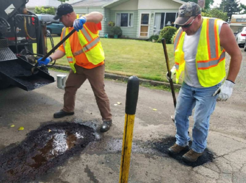 COURTESY PBOT - Workers filling potholes as part of Fixing Our Streets program.