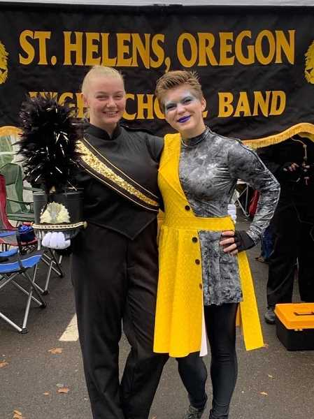 BRI BROGLI PHOTOGRAPHY - Shelby Turcotte, left, and Alana Saul, both seniors and best friends, pose for a photo. The teens will be embarking on a 20-stop tour with Seattle Cascades Drum and Bugle Corps in July.
