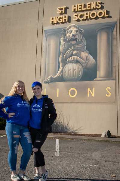 BRI BROGLI PHOTOGRAPHY - Shelby Turcotte, left, and Alana Saul, both seniors and best friends, pause for a quick photo outside the mural at St. Helens High School.