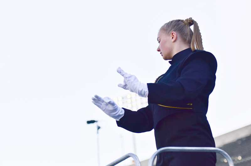 COURTESY IMAGE - Shelby Turcotte, in her role as drum major, directs the St. Helens Marching Band and Color Guard. Turcotte auditioned for an assistant drum major position through Seattle Cascades Drum and Bugle Corps but was ultimately tapped to be the corps' head drum major.