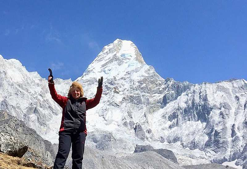 COURTESY IMAGE - Rosemary Jeffrey of Columbia City in the shadow of a Himalayan peak. Jeffrey returns to the region annually to deliver supplies to schoolchildren. She has a speaking engagement at the Columbia City Community Library on Feb. 20.