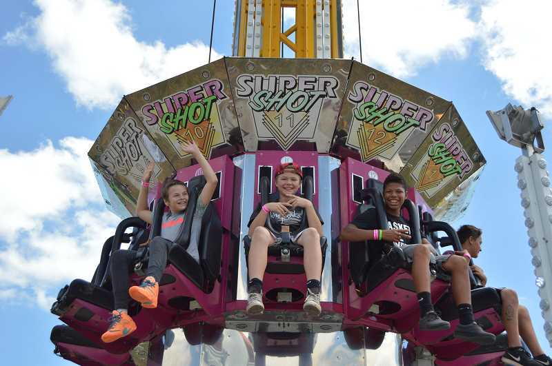 PMG FILE PHOTO - Thrill-seekers at the Columbia County Fair and Rodeo take a ride on the Super Shot.