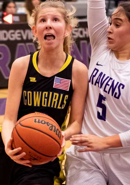 LON AUSTIN/CENTRAL OREGONIAN - McCall Woodward goes to the hoop in the Cowgirls' game against Ridgeview last Friday. Tuesday night, Woodward scored 10 points as CCHS defeated Hood River Valley 53-32.
