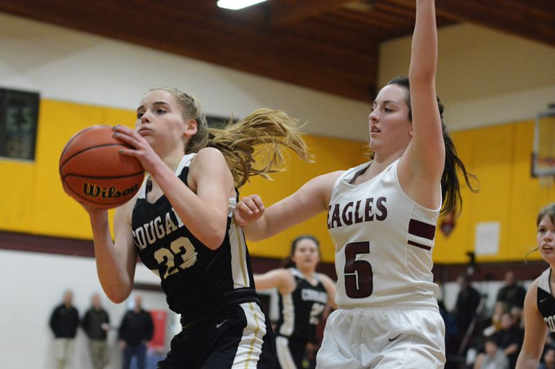 PMG PHOTO: DAVID BALL - Country Christians Lizzy Grandle pulls down a pass ahead of Damascus Christians Sierra Hale during the Cougars 44-43 buzzer-beating loss Monday, Feb. 3.