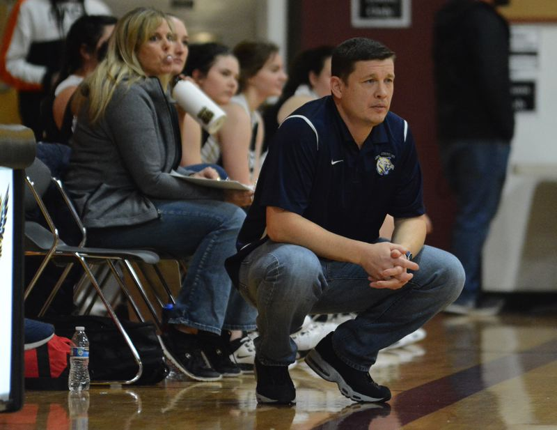 PMG PHOTO: DAVID BALL - Country Christian coach Russell Halverson takes in the action from the sideline.