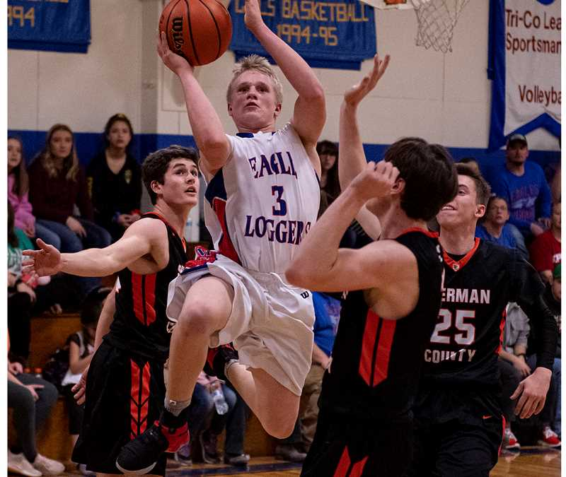 LON AUSTIN/CENTRAL OREGONIAN - Nathan Clark goes to the basket for two of his 15 points as the Mitchell/Spray Eagle/Loggers defeat the Sherman County Huskies 55-45 Saturday afternoon in Mitchell. Clark, a freshman, was one of three Eagle/Loggers in double figures in the game.