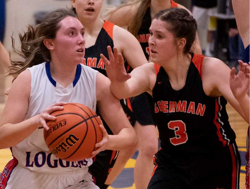 LON AUSTIN/CENTRAL OREGONIAN - Alayna Denney is fouled on her way to the basket Saturday against Sherman County. Denney finished with six points as the Eagle/Loggers fell to the Huskies.