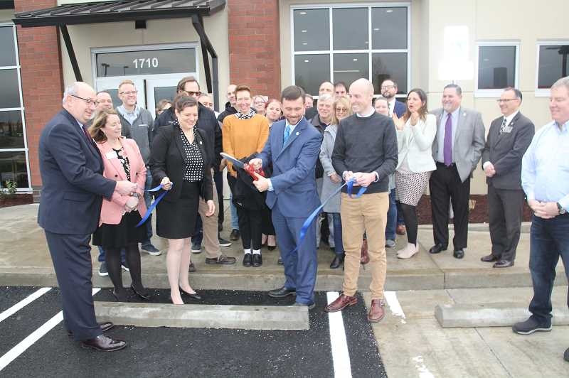 PMG PHOTO: JUSTIN MUCH - On Friday, Feb. 7, a couple dozen celebrants turned out for a ribbon cutting to celebrate Woodburns Oregon State Credit Unions move into its new building, located between Wheeler Dealer and Coastal Farm & Ranch.