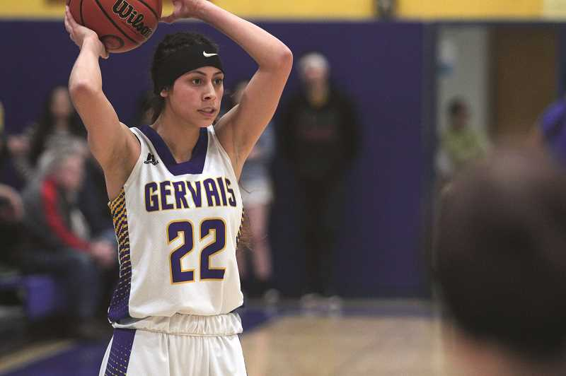 PMG PHOTO: PHIL HAWKINS - The Gervais High School community celebrated Senior Night as 'Bella Night' in honor of the Cougars' lone senior — Bella Vasquez. Teammates wore commemorative t-shirts on the bench, as did fans throughout the crowd.