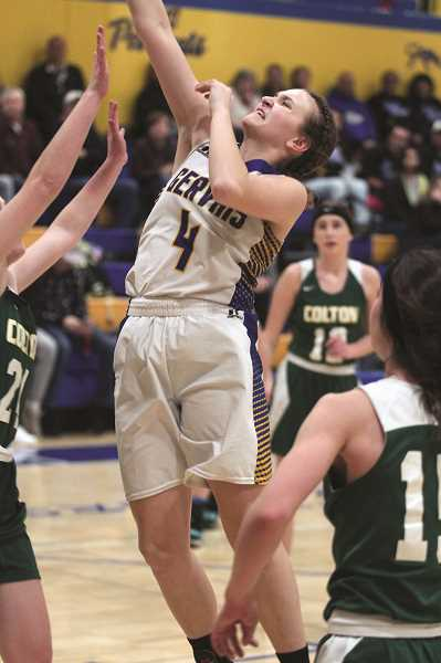 PMG PHOTO: PHIL HAWKINS - Gervais freshman Izzy Boyd goes up for a contested shot in the paint against Colton sophomore Olivia Haines.